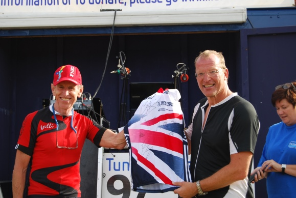 Rugby coach John Watson from Marlow receives his autographed GB cycling jersey from former Olympic track cyclist Willi Moore